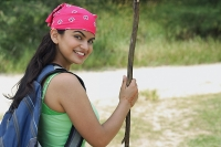 Young woman hiking and smiling at camera - Asia Images Group
