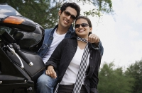 Young couple with motorbike - Asia Images Group