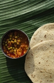 Still life of chapati and mixed vegetable curry on a banana leaf - Asia Images Group