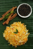 Still life of saffron rice, black pepper and cinnamon sticks - Asia Images Group