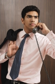 Businessman talking on the phone - Asia Images Group