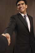 Businessman smiling and shaking hands - Asia Images Group