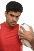 Young man with rugby looking at camera - Asia Images Group