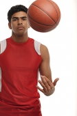 Young man with basketball looking at camera - Asia Images Group