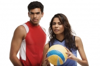 Young couple with beach ball looking at camera - Asia Images Group