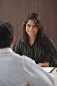 Businesswoman smiling at man - Asia Images Group