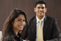 Businessman and woman smiling at camera - Asia Images Group