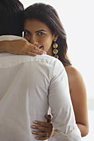 woman peaking over man's shoulder - Vivek Sharma