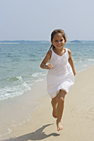 little girl running on beach - Alex Mares-Manton