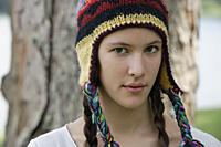 Teen girl wearing hat, next to tree - Nugene Chiang