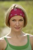 portrait of young woman in headband - Alex Mares-Manton