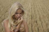 Young women standing in field - Alex Mares-Manton