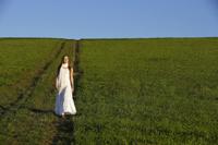 Young woman walking down hillside - Alex Mares-Manton