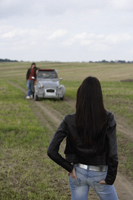 Young man next to car, young woman in foreground - Alex Mares-Manton
