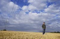 Young man in field - Alex Mares-Manton
