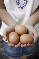 girl holding brown eggs - Alex Mares-Manton
