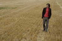 Young man standing in a field - Alex Mares-Manton
