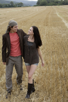 Young couple walking through field - Alex Mares-Manton