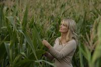 woman standing amid corn stalks - Alex Mares-Manton