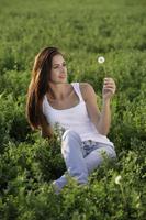 young woman holding dandelion - Alex Mares-Manton
