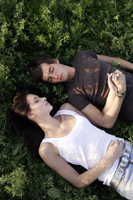 Young couple lying in field - Alex Mares-Manton