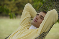 Young man resting in hammock - Alex Mares-Manton