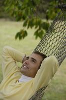 Young man resting in hammock - Alex Mares-Manton