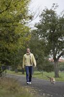 Young man walking dog - Alex Mares-Manton