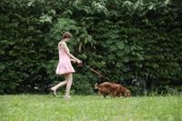 Young woman walking dog - Alex Mares-Manton