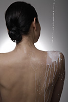 Milk being poured down a woman's back - Nugene Chiang