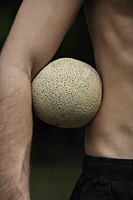 melon under man's arm - Nugene Chiang