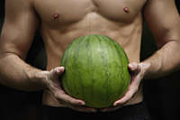 watermelon held by hands of man - Nugene Chiang