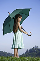 young girl with bright green umbrella - Nugene Chiang