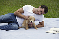 man at park with puppy - Nugene Chiang