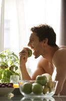 Profile of man eating apple - Alex Mares-Manton