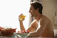 Profile of young man drinking juice - Alex Mares-Manton