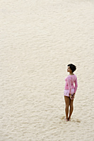 woman wearing pink and standing on sand - Alex Mares-Manton